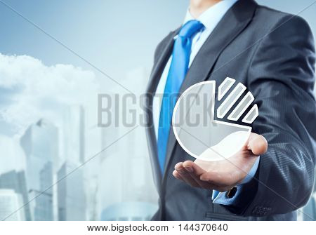 Close up of businessman hand presenting digital market diagram pie