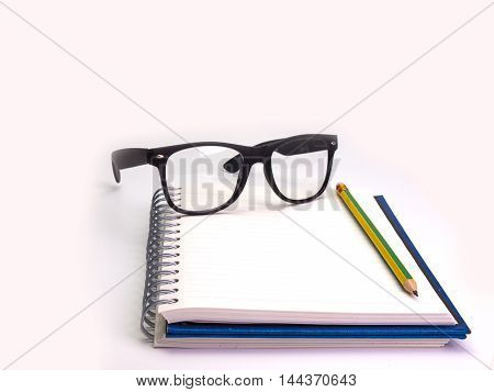 Pencil book and glasses Placed on a white background. (Space for your text)