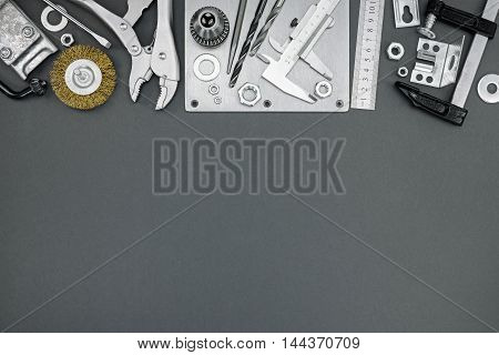 Clamps, Vernier Caliper, Ruler, Drill And Other Tools On Grey Background
