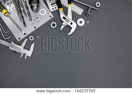 Set Of Different Metal Tools And Instruments On Grey Background