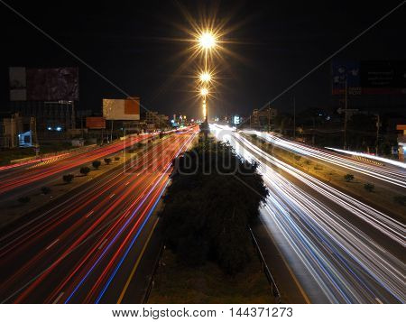 light trails on road in city night scene