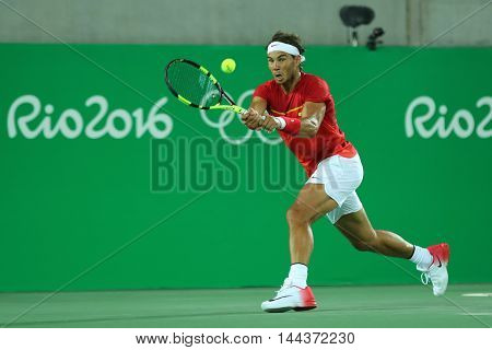 RIO DE JANEIRO, BRAZIL - AUGUST 12, 2016: Olympic champion Rafael Nadal of Spain in action during men's doubles final of the Rio 2016 Olympic Games at the Olympic Tennis Centre