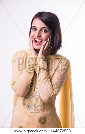 Portrait of an young indian girl surprised, isolated over white background