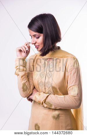 shy indian pretty woman with arms crossed against white background