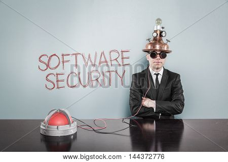Software security concept with vintage businessman and alert light