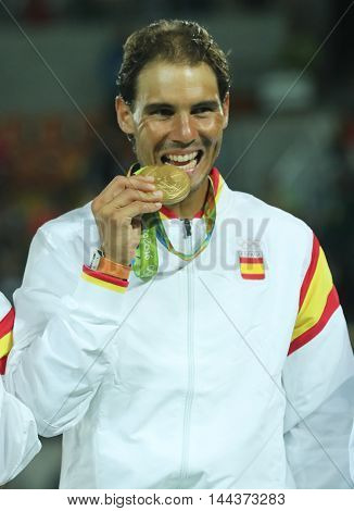 RIO DE JANEIRO, BRAZIL - AUGUST 12, 2016: Olympic champion Rafael Nadal of Spain during medal ceremony after victory at men's doubles final of the Rio 2016 Olympic Games