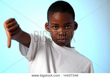 African boy thumbs down sign