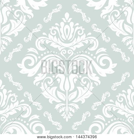 Seamless oriental ornament in the style of baroque. Traditional classic pattern. Light blue and white pattern