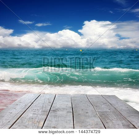 wooden pier and waves on the surface of the sea