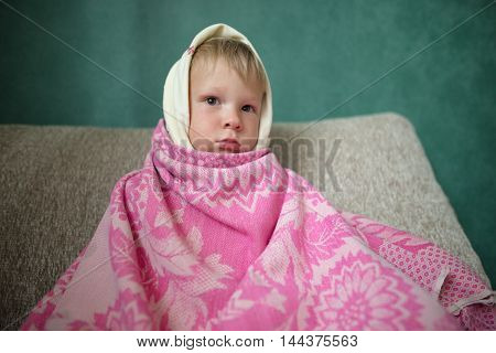 Boy Wrapped In A Scarf. Caught A Cold