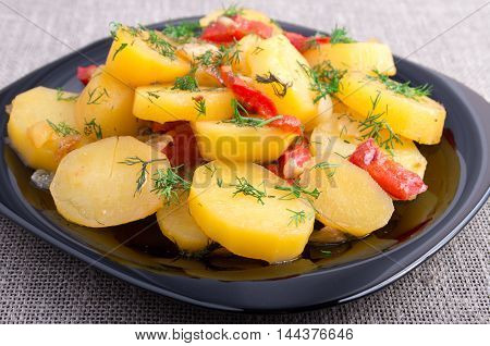 Close Up View On Stew Of Potatoes With Onion, Bell Pepper