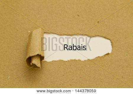 French Word Rabais (Discount) written under torn paper.