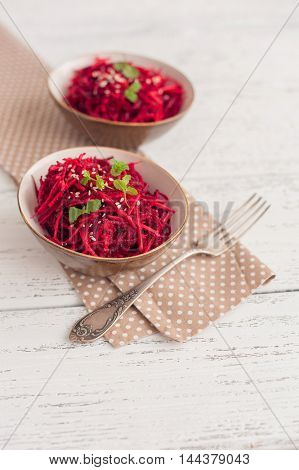 Salad with beetroot, carrot, garlic and mint leaves.