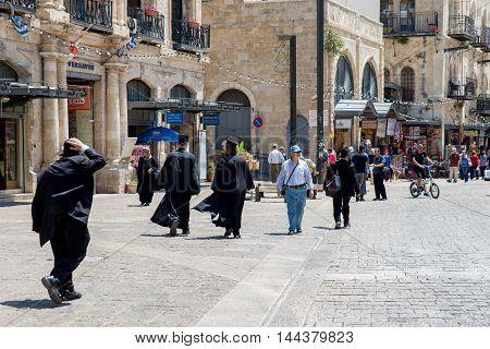 JERUSALEM, ISRAEL - JUNE 1, 2015: People walk through the old town
