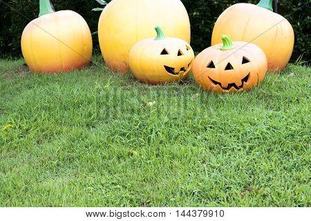 Clay sculpture Haloween pumpkins on the grass