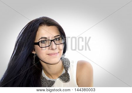 Young beautiful girl in glasses on grey light background