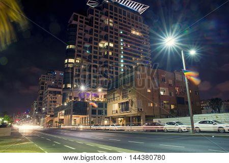 TEL AVIV, ISRAEL - JUNE 4, 2015: View of the business district with modern buildings in Tel Aviv at night. June 4, 2015. Tel Aviv, Israel.