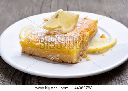 Piece of lemon pie on plate country style