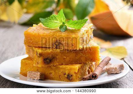 Sliced pumpkin pie on plate, autumn dessert