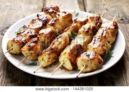 Chicken kebab on plate close up view
