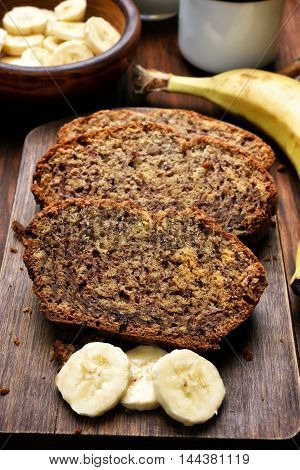 Slices of homemade banana bread on wooden board