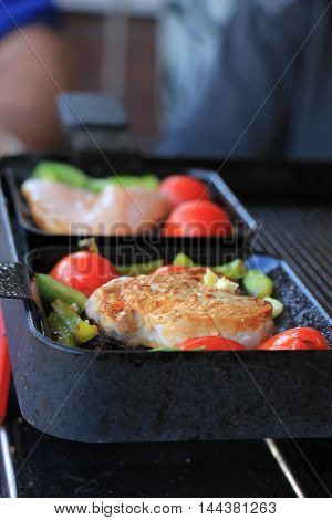Small piece of fresh meat in a pan meat raclette