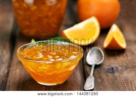 Orange jam on wooden table focus on jam in bowl shallow depth of field