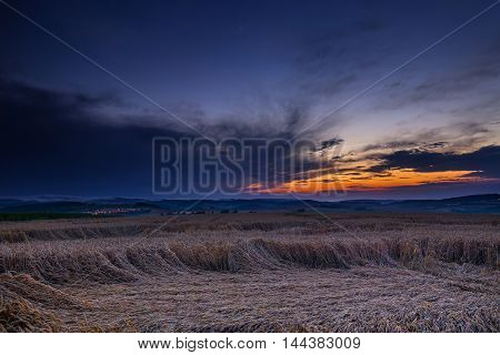 Sunset and ripened grain. Moravian landscape Boskovice.