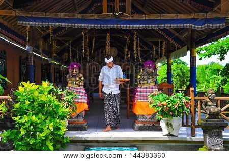 Bali,Indonesia-May 30,2010:Balinese man after praying at Hindu Temple in Trunyan, Bali, Indonesia on 30th May 2010.Balinese practices Hinduism for their religion.