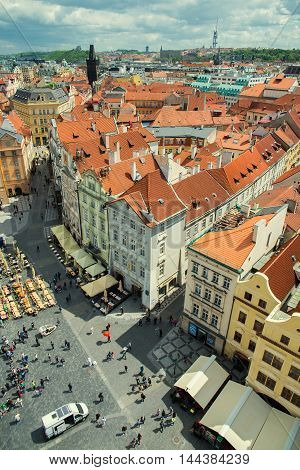 PRAGUE, CZECH REPUBLIC - MAY 6, 2015: The view from the height of the orange roofs of the old town. May 6, 2015. Prague, Czech Republic.