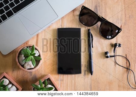 top view smartphone with blank screen on wood deskmorning time.