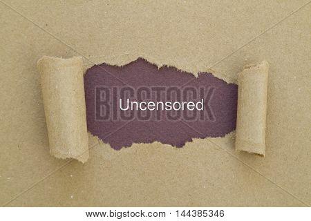 uncensored word written under torn paper .
