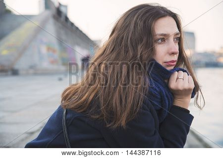 girl sitting on the bank of the river