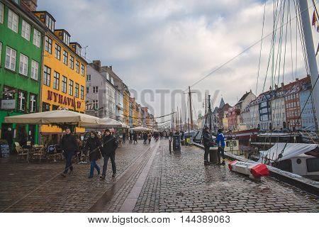 COPENHAGEN, DENMARK - 30 DECEMBER, 2014: Nyhavn is a 17th-century waterfront, canal and entertainment district in Copenhagen, Denmark