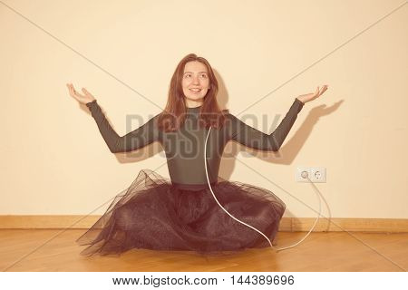cheerful woman is charged from the power outlet