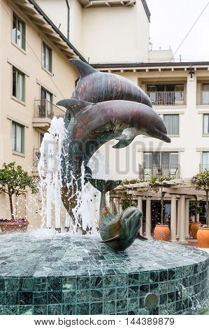 Dolphin fountain in Cannery Row near Monterey