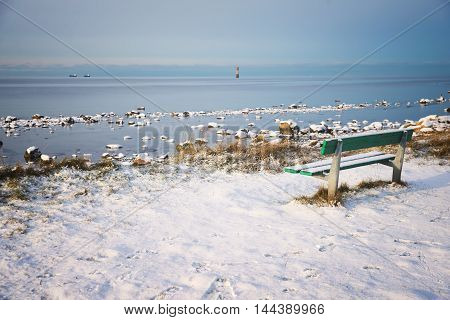 bench on the shore of the Strait of Oresund