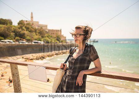 Girl resting on the embankment in Tel Aviv