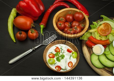 Fresh vegetables for snacks with dressing. Dip for vegetables. Healthy diet meal for dinner. Preparing vegetables in a home kitchen.