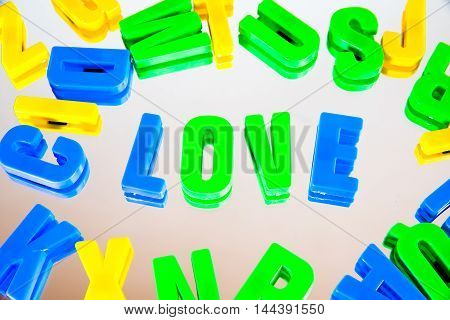 word love from plastic letters on a white background