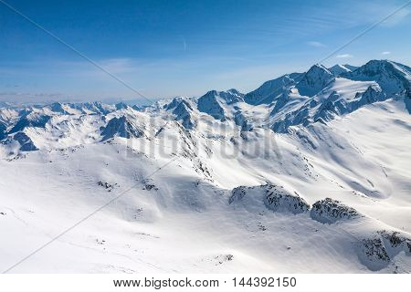Winter snow covered mountain peaks in Austrian alps  Place for winter sports