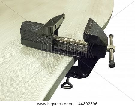 New black bench vice on table isolated on white background