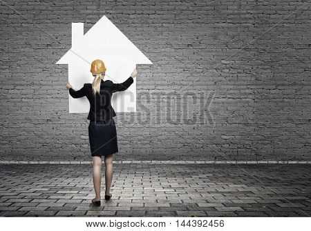 Woman engineer with banner . Mixed media