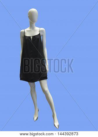 Female mannequin wearing black dress against blue background. No brand names or copyright objects.