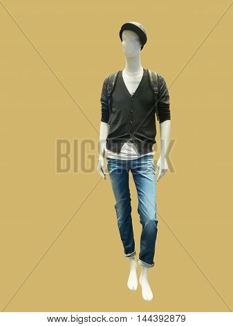 Full length male mannequin dressed in jacket and blue jeans isolated on yellow background. No brand names or copyright objects.
