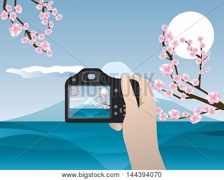 Camera in hand. Travel photo of mount Fuji. Banner for website template posters