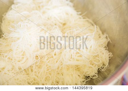 Depth of field of boiled rice noodles for asian cooking