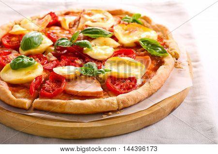 Mozzarella tomato and smoked chicken homemade pizza