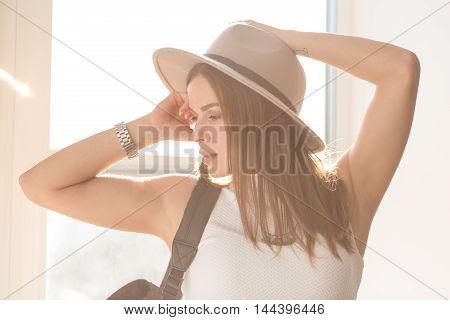 Beautiful boho woman standing by the window