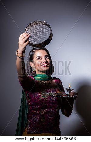 Young Indian woman celebrating Karwa chauth festival